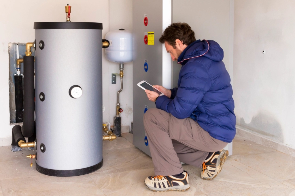 Man checking a water heater