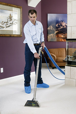 Man vacuuming a floor