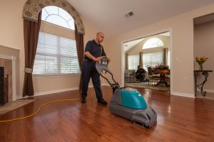 ServiceMaster Tech Cleaning Wood Floors