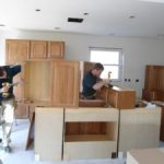 Man working on cabinets